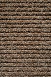 Striped pattern of a carpet. Texture of a brown striped fabric of a carpet stock photos
