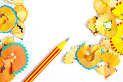 Striped pencil and colored shavings Royalty Free Stock Image