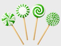 Set of green christmas candy on wooden stick vector illustration