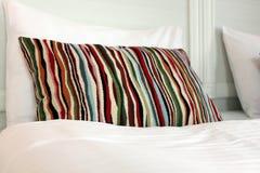 Striped pillow on a white bad Stock Photos