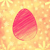 Pink easter egg over yellow old paper background with flowers Stock Images