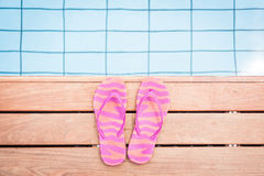 Striped Pink Flip Flops By The Pool Stock Image