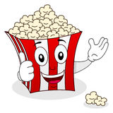 Striped Popcorn Bag Character Smiling. A funny cartoon striped popcorn paper bag character smiling with thumbs up, isolated on white background. Eps file Stock Image
