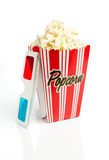 Striped popcorn box with 3d glasses. Popcorn box with 3d glasses on white royalty free stock photo