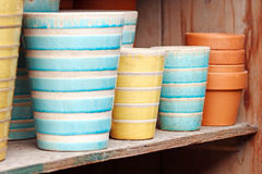 Striped Pots. Blue and yellow striped gardening pots Royalty Free Stock Image