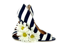 Striped pumps with daisy bouquet Stock Photo