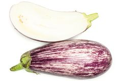Fresh Raw purple striped Eggplant isolated on white. Striped purple eggplant collection top view isolated on white background one whole and sliced section half Royalty Free Stock Image