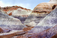 Striped purple sandstone formations of Blue Mesa badlands in Petrified Forest National Park Stock Photo