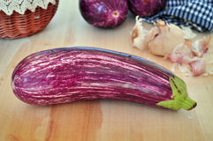 Striped raw eggplants. Striped raw eggplant purple color laid on a kitchen cutting board Royalty Free Stock Photo
