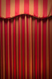 Striped red and gold curtains Stock Image