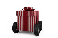 Striped red and white gift box on wheels Royalty Free Stock Image