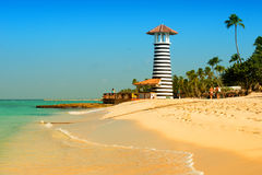 Striped red white lighthouse on the coast of the Caribbean Sea. Dominican Republic. Royalty Free Stock Photos
