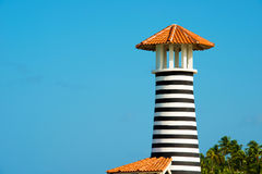 Striped red white lighthouse on the coast of the Caribbean Sea. Dominican Republic. Stock Photos