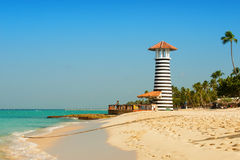 Striped red white lighthouse on the coast of the Caribbean Sea. Dominican Republic. Royalty Free Stock Photo