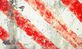 Striped red and white lines  over old grungy concrete wall Stock Photo