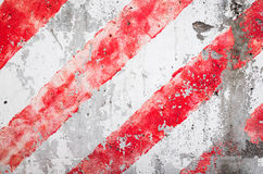 Striped red and white pattern over concrete wall Royalty Free Stock Images