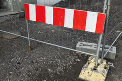 Striped red and white road barrier stock image