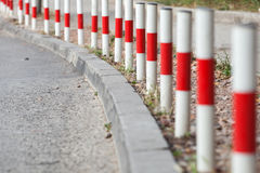 Striped red and white signal poles Stock Image