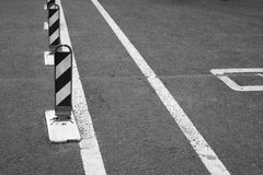 Striped road warning posts and road markings Royalty Free Stock Images