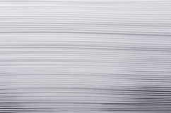 Striped rough white texture of pages paper with contrast gradient, abstract background. Stock Image