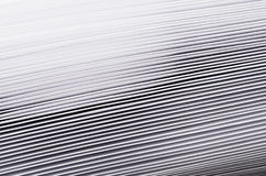 Striped rough white texture of pages paper with contrast gradient, abstract background. Stock Photos