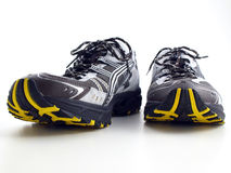 Striped Running Shoes on white front view Royalty Free Stock Image