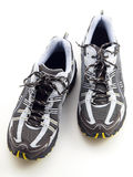 Striped Running Shoes on white top view Royalty Free Stock Images