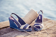 Striped sandals, lie on breast lake, ball of yarn, Women's Shoes. A Royalty Free Stock Photography