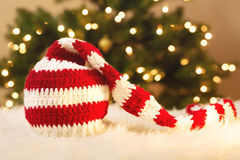 Striped Santa Hat on white carpet Stock Photography
