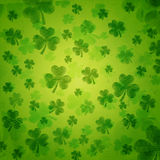 Striped shamrocks in green old paper background Stock Photography