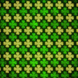 Striped shamrocks in green old paper background out of focus Royalty Free Stock Image