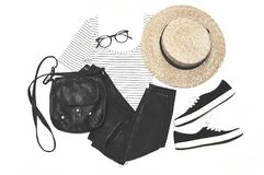 Striped shirt, black jeans, moccasins, straw hat, bag and glasses stock image