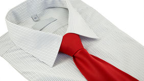Striped shirt with red silk necktie over white Stock Photo