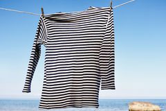 Striped Shirt. On the sea background royalty free stock image