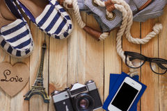 Striped slippers, camera, phone and miniature of Eiffel Tower, top view Stock Photo