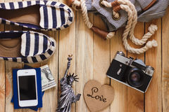 Striped slippers, camera, phone and miniature of the statue of liberty, top view Stock Images