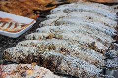 Striped snakehead fish grilled in a salt crust in the market. Royalty Free Stock Photo