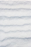 Striped snow as background Stock Images