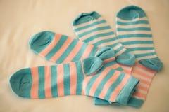 Striped socks on beige backdrop Stock Photo