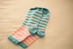 Striped socks on beige backdrop Royalty Free Stock Photos