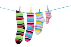 Striped socks. Colorful striped socks hanging on a white background Stock Photos