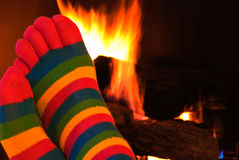 Striped socks by fireplace Royalty Free Stock Photo