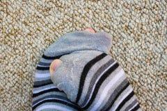 Striped socks full of holes royalty free stock photo