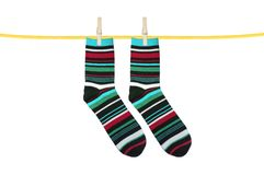 Striped socks hanging isolated on white. Background Royalty Free Stock Image