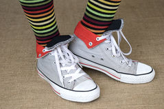 Striped socks and sneakers Stock Images