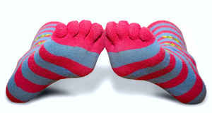 Striped socks with toes. A pair of striped socks with toes Royalty Free Stock Image