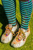 Striped socks and trainers covered in bright powder paint stock images