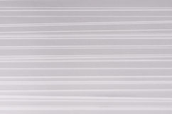 Striped stepped soft white and grey abstract paper texture with halftone perspective. Stock Photo