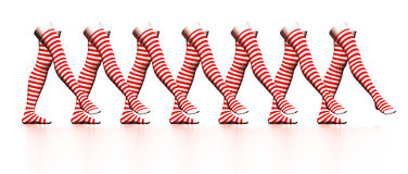 Striped stockings. Row of dancing red striped stockings Stock Photo