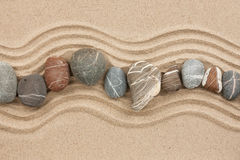Striped stones on the sand Royalty Free Stock Photography